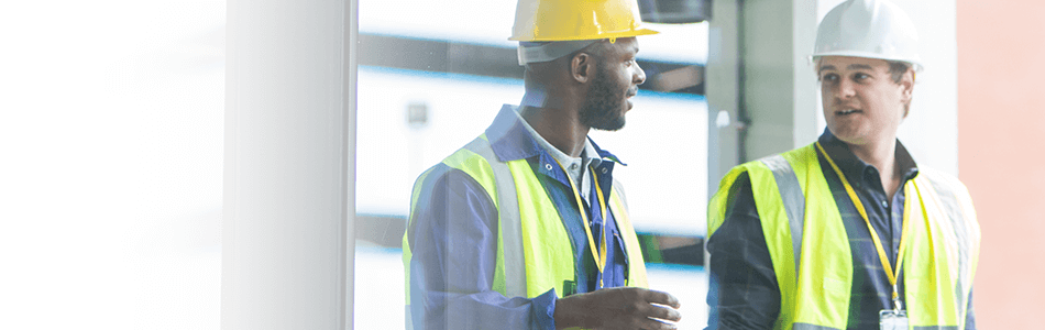 Construction workers talk full width