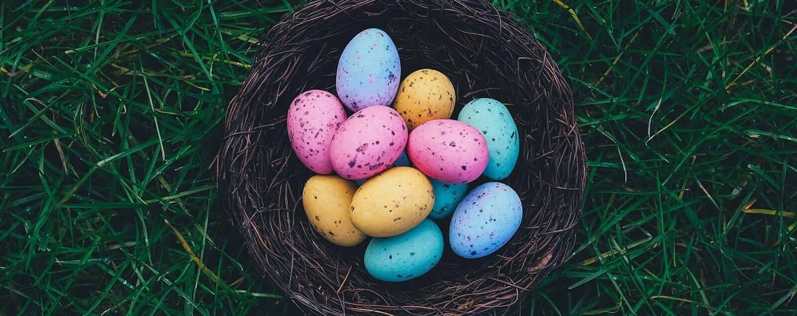 Coloured eggs in a thatch basket