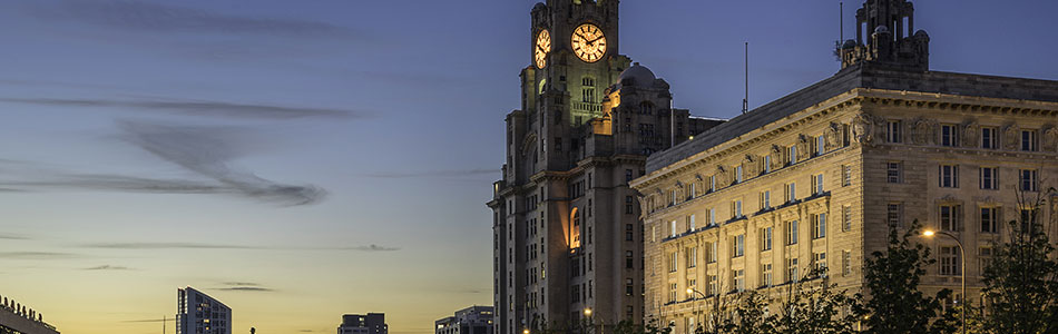 Liverpool's Liver Building clock tower illuminated at night small